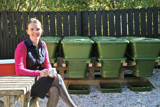 Hungry Bin Worm Farm - Angie Redfern, Owner of Ripe Café in Auckland enjoys a coffee in the cafe's garden.